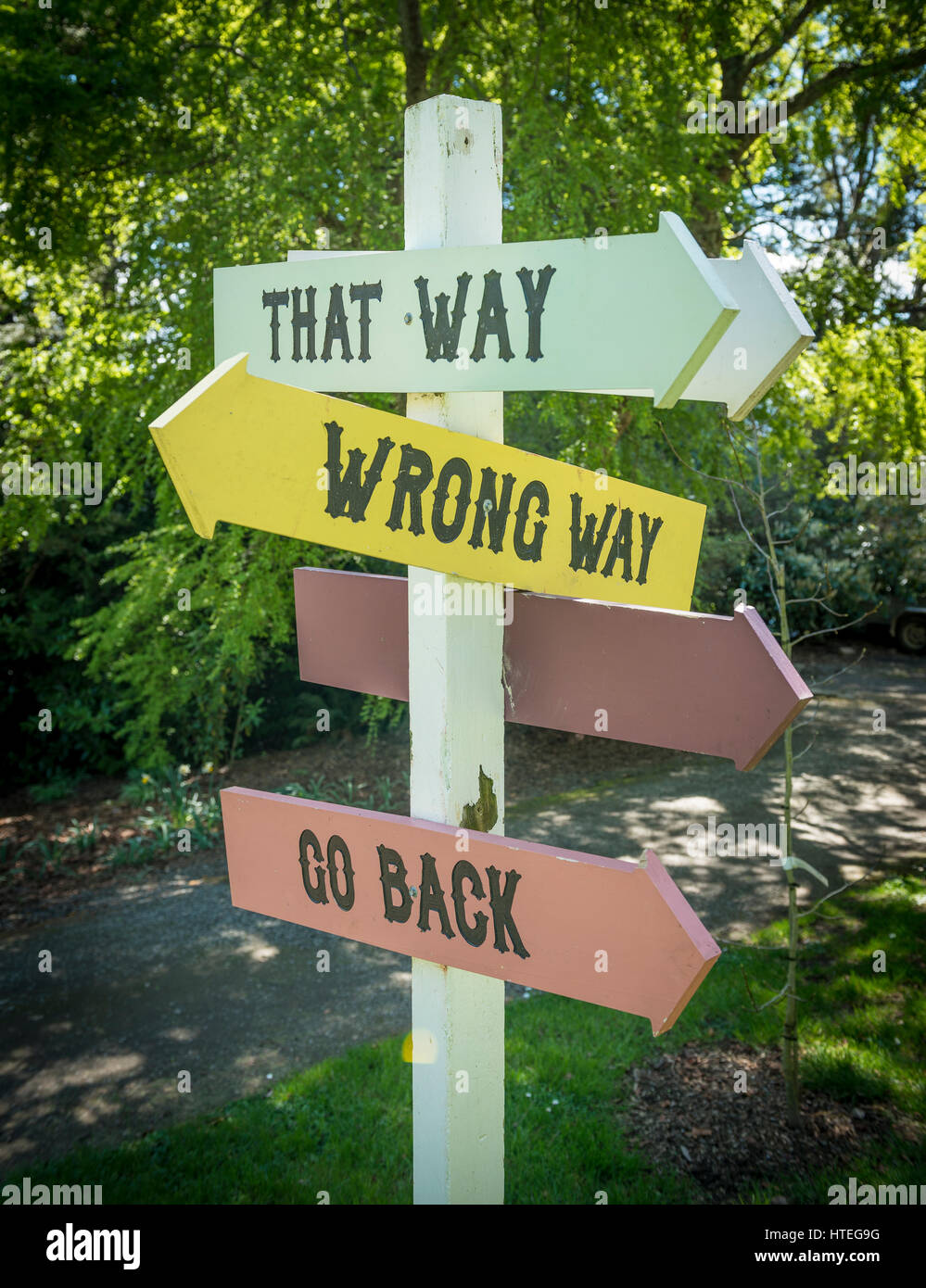 Curios sign post, That Way, Wrong Way, Go Back, Larnach Castle, Otago, New Zealand - Stock Image