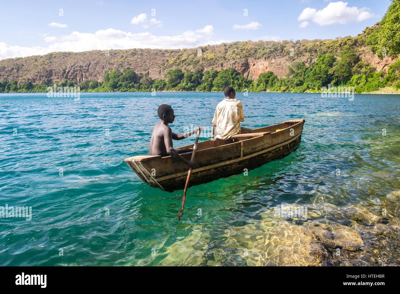 Africans in canoe, Chala lake, border Kenya and Tanzania - Stock Image
