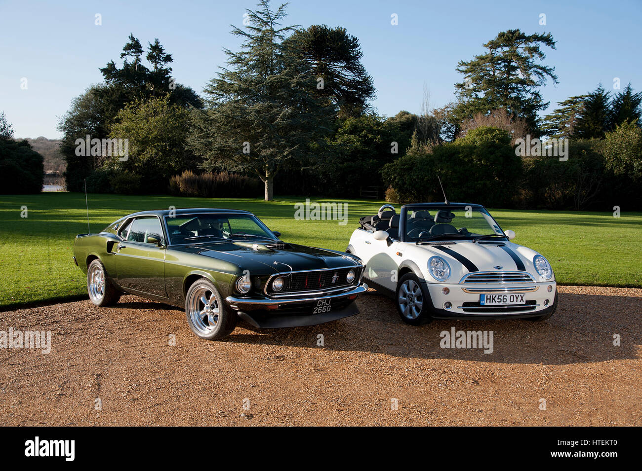 1968 Ford Mustang and 2006 Mini Cooper convertible - Stock Image