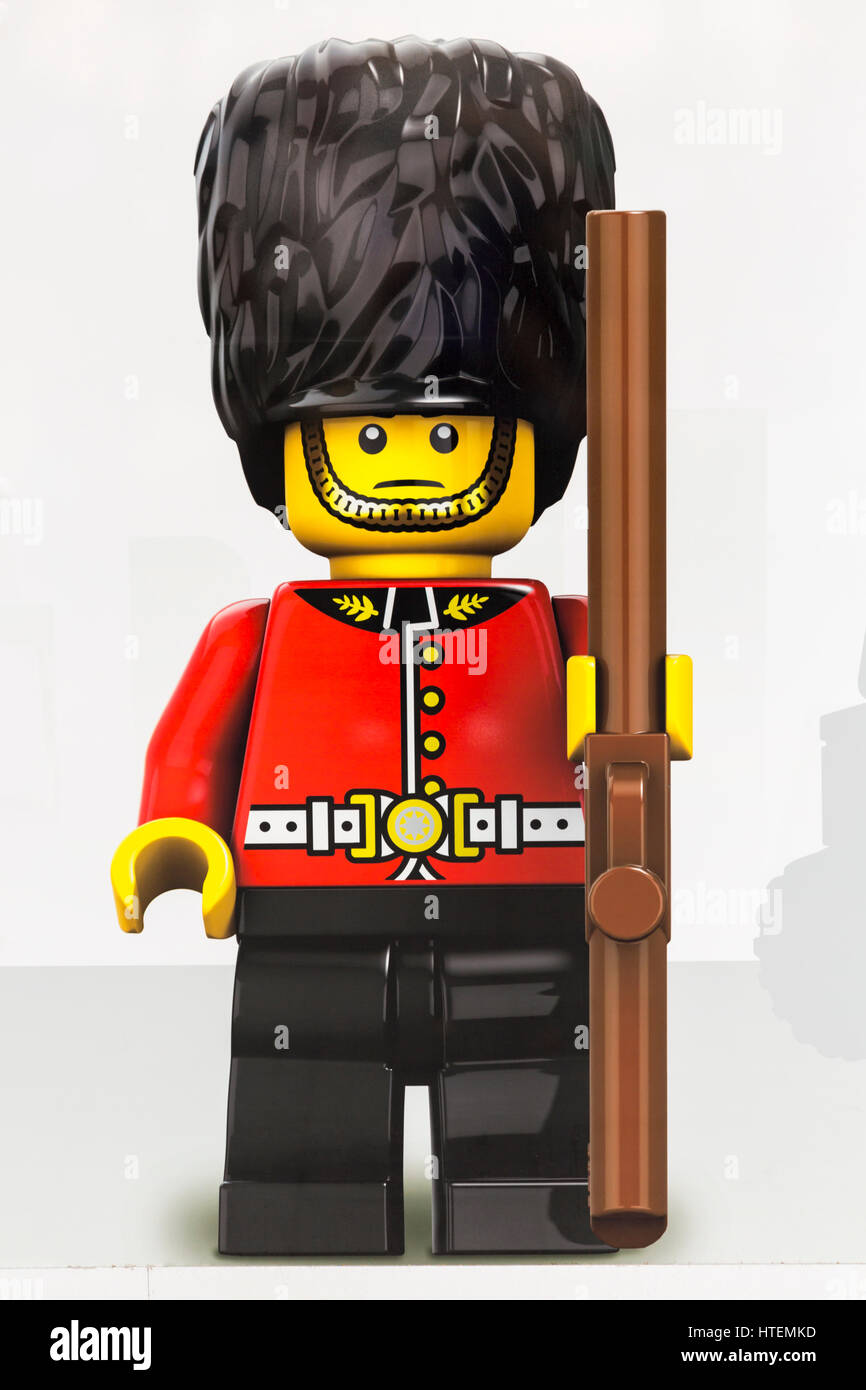 Lego figure on hoardings of new LEGO store under construction and due to open soon in Leicester Square, London - Stock Image