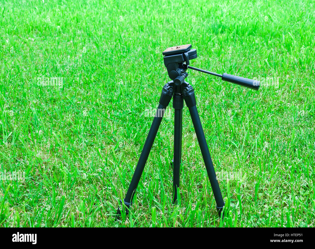 A tripod for the camera on natural background - Stock Image