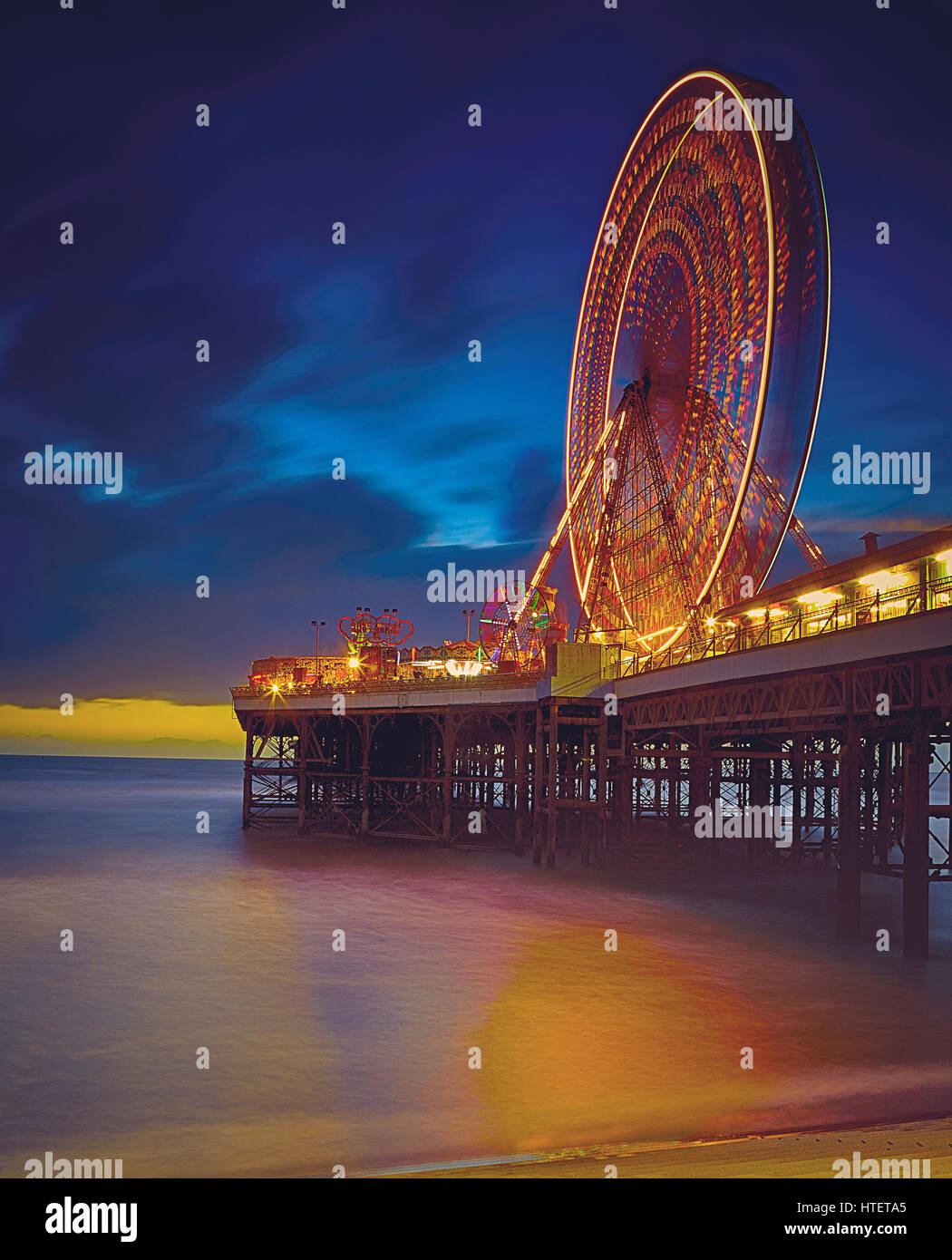 Long Exposure Night Image of Ferris Wheel on Pier at Blackpool - Stock Image