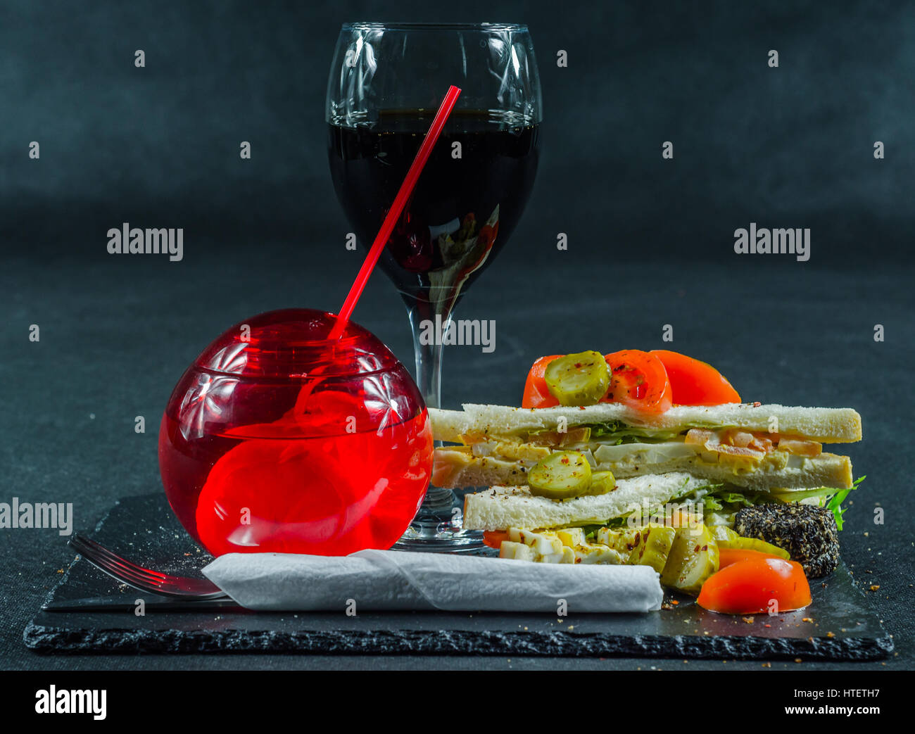 set consisting of two sandwiches on white bread with sliced egg, cucumber, pickles, mayonnaise, salat cream, tomato, - Stock Image