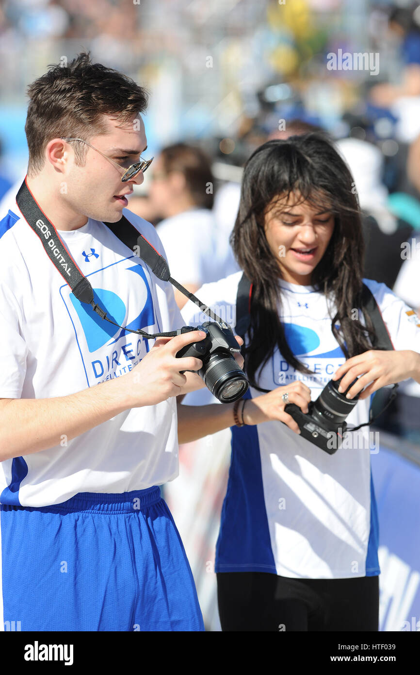 Ed Westwick and Jessica Szohr at the DIRECTV 4th Annual Celebrity Beach Bowl on February 6, 2010 in Miami Beach, - Stock Image