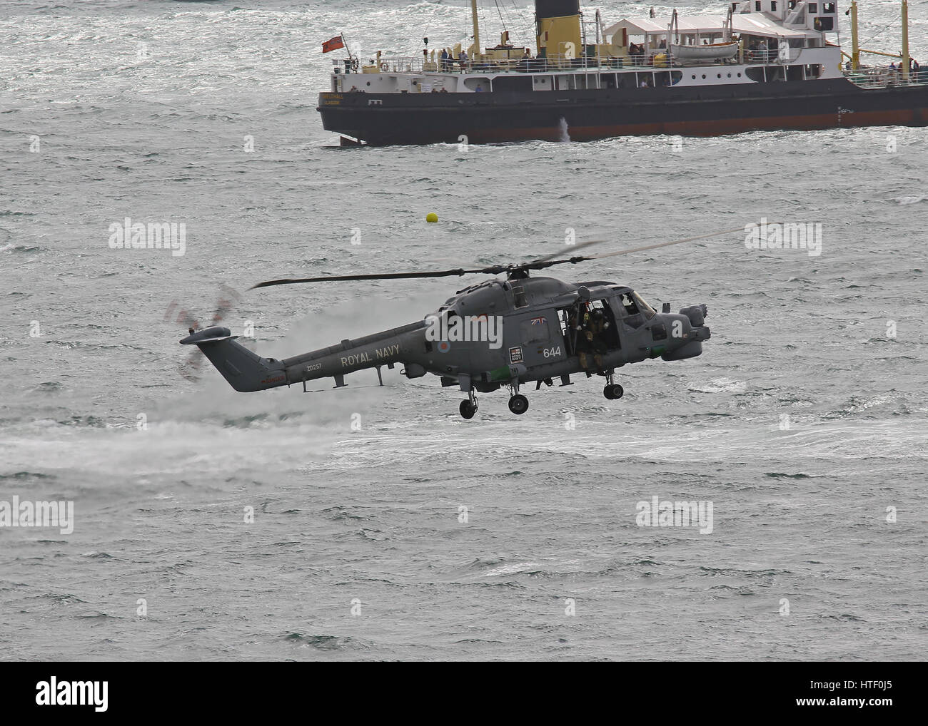 A Royal Navy Lynx HMA.8 hovering low over the sea during the Bournemouth Air Festival, UK - Stock Image