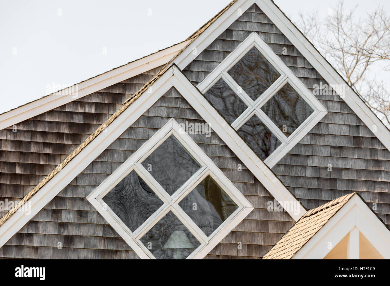 two square windows with four panes each on a home - Stock Image
