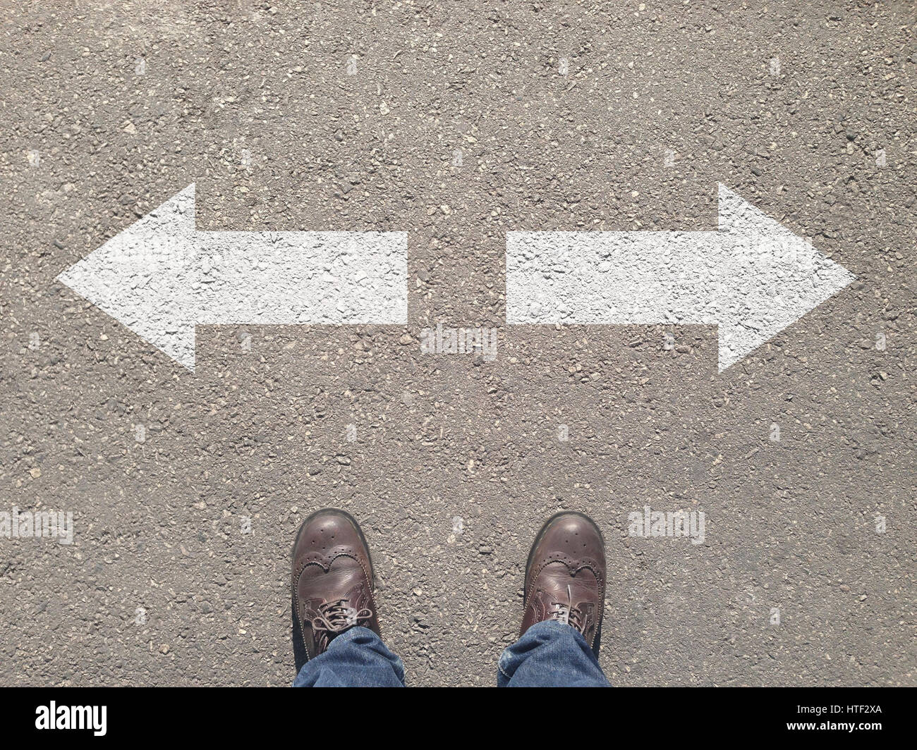 standing at the crossroad making decision which way to go - easy or hard - Stock Image