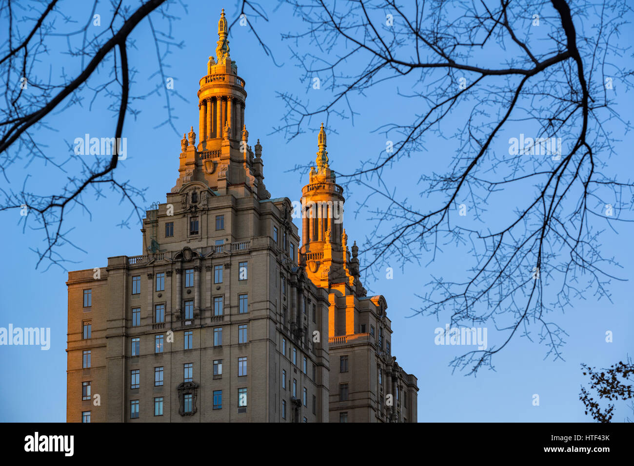 Last sunset light on the two towers of the San Remo apartment building. Central Park West, Upper West Side, Manhattan, - Stock Image