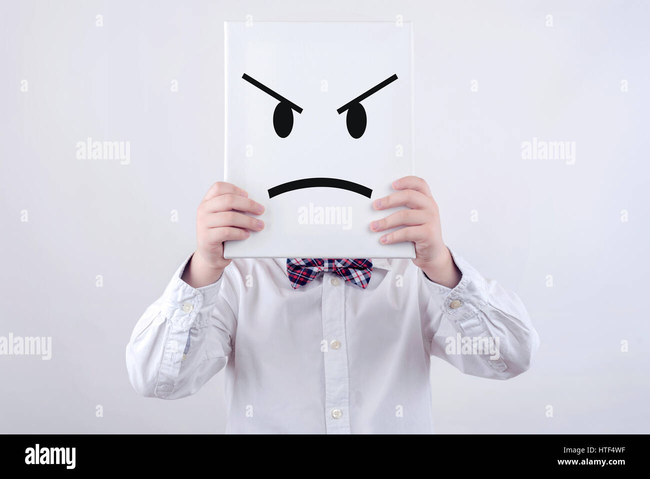 Angry child with white board - Stock Image