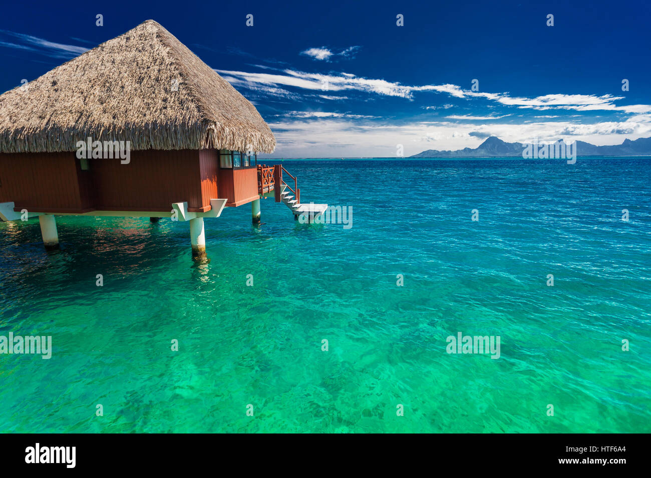 Overwater bungalows with best beach for snorkeling, Tahiti, French Polynesia - Stock Image