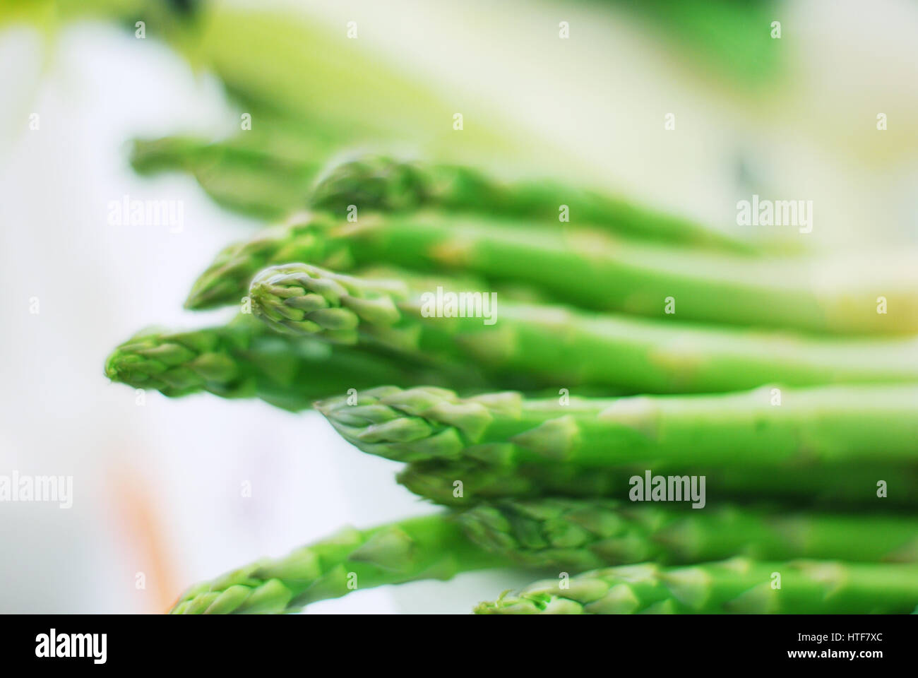 Bundle of fresh asparagus on white background Stock Photo