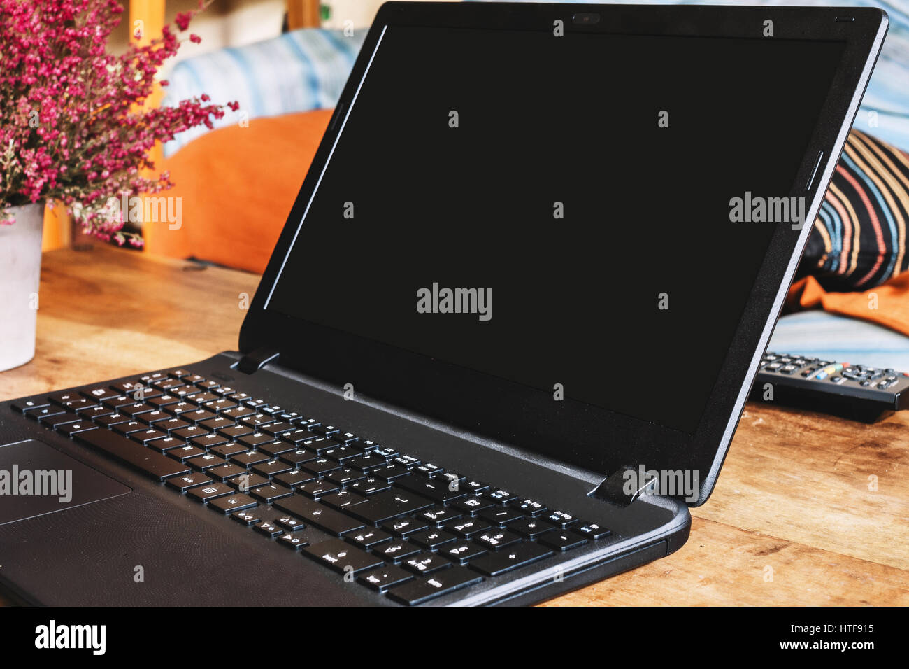 Laptop screen on wood table - Stock Image