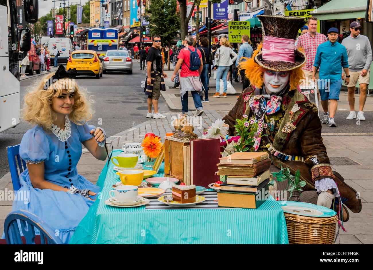 Alice in wonderland reenactment of mad hatters tea party Camden London England - Stock Image