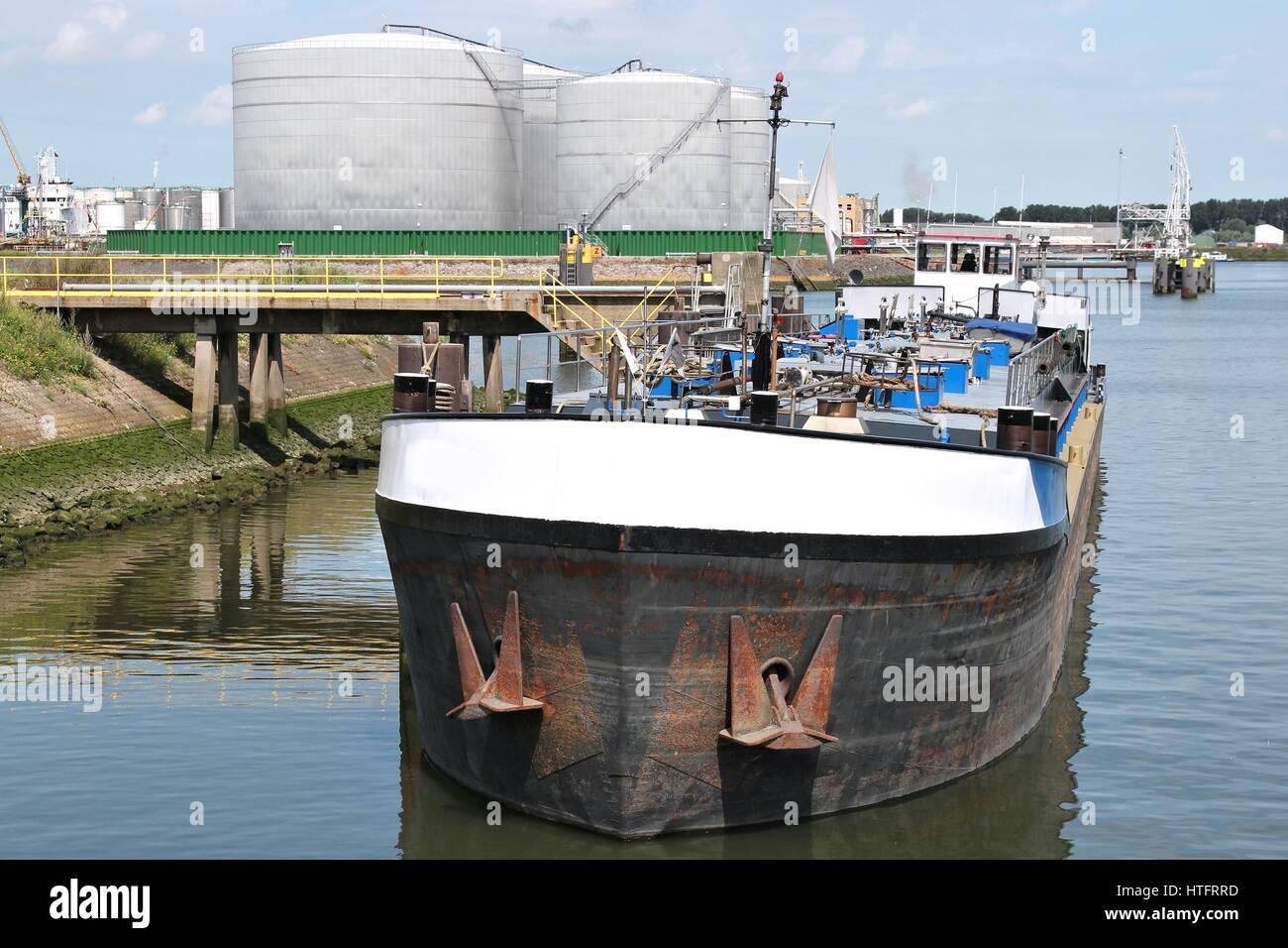 inland tanker vessel in harbor - Stock Image