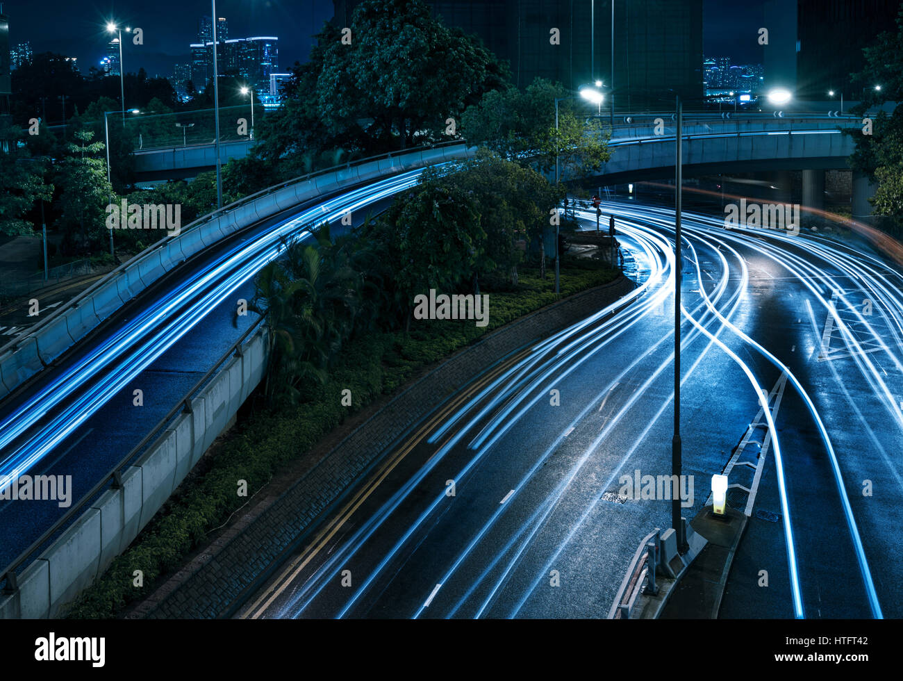 beautiful light trail at the busy highway - Stock Image