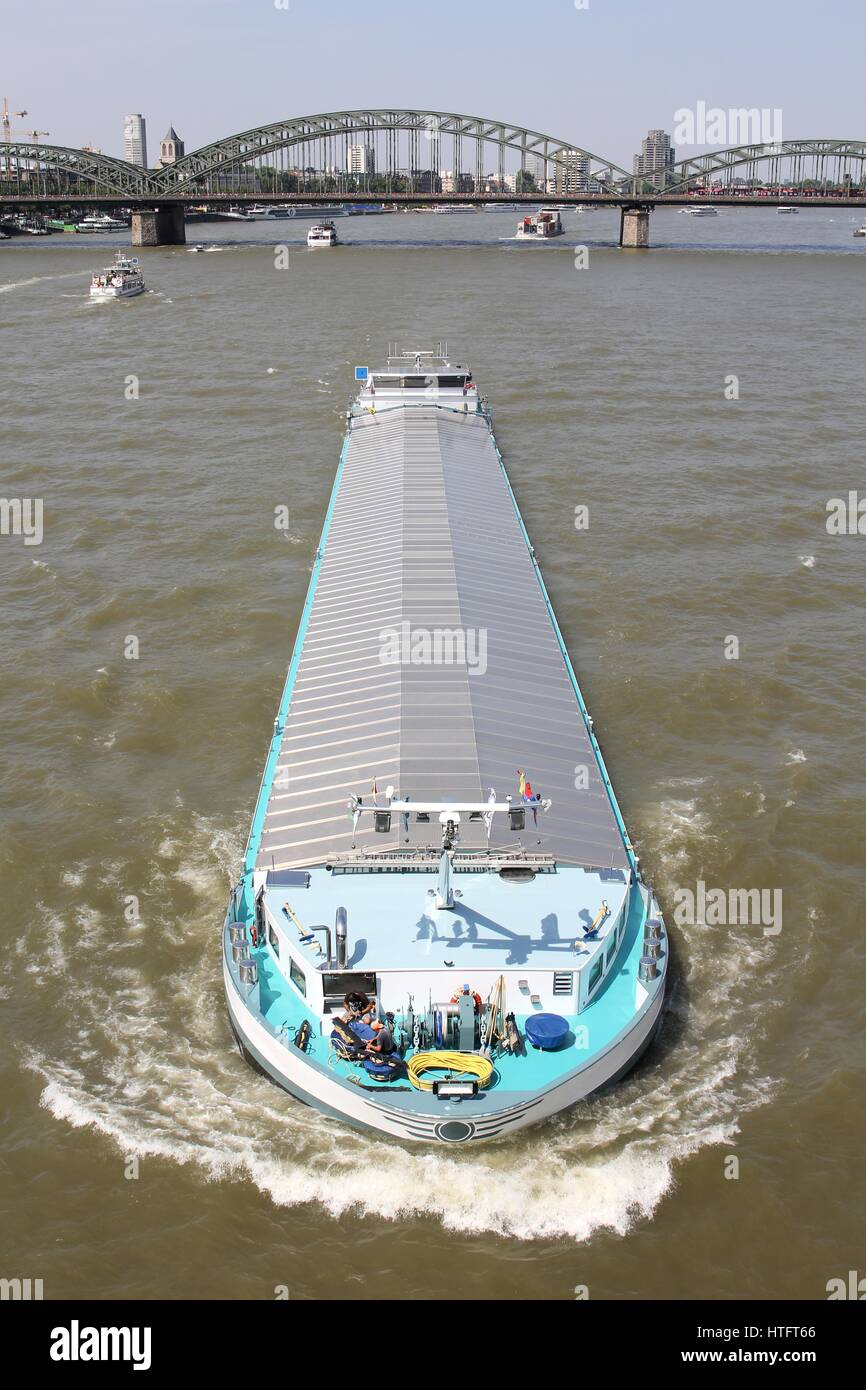 inland general cargo vessel shipping on the river Rhine - Stock Image
