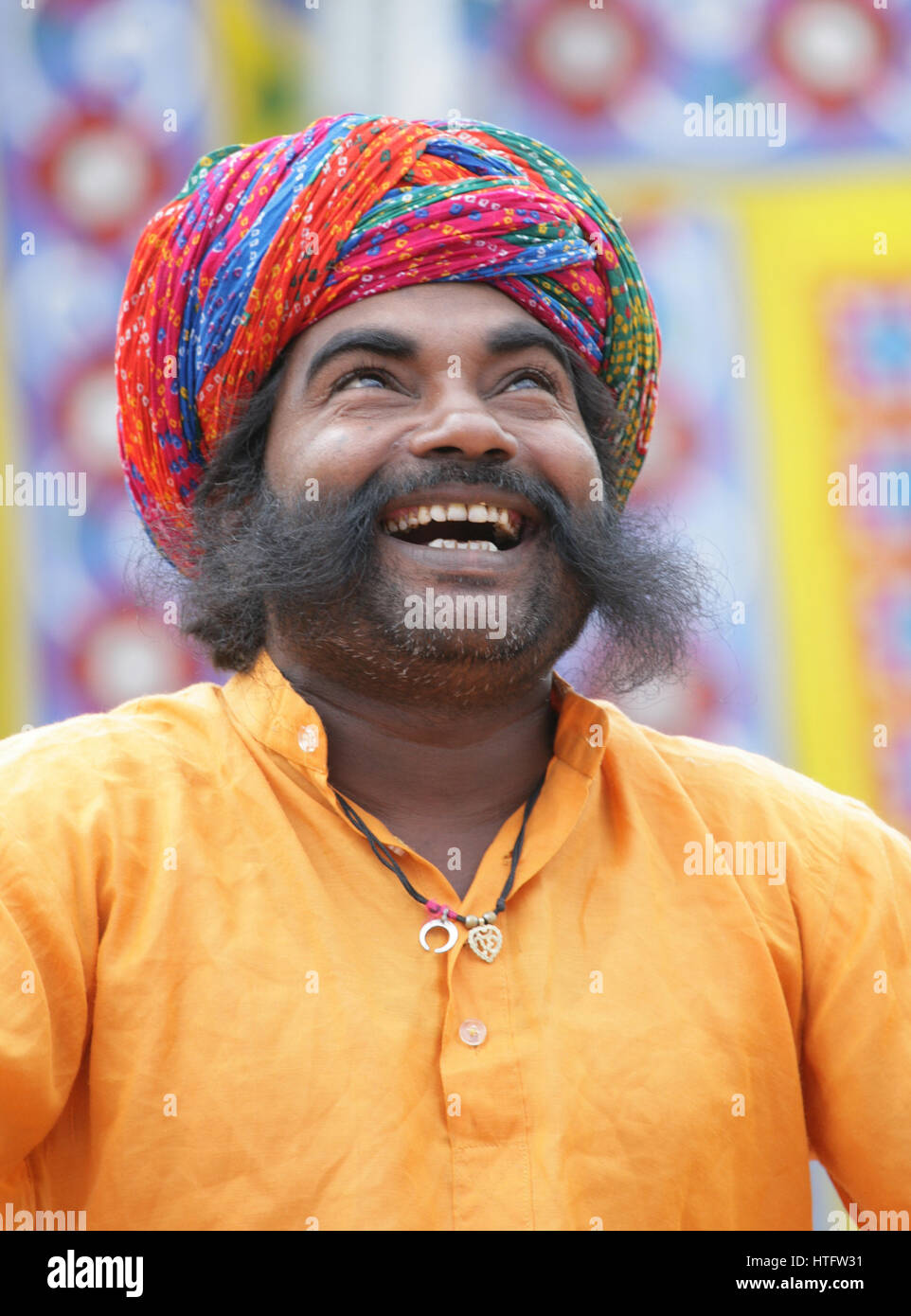Indian man laughing. Colourful portrait, full frame photograph full of infectious joy and  happiness.  Happiness - Stock Image