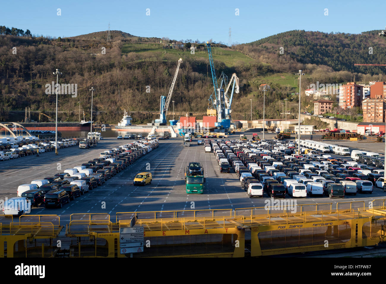 Pasajes seaport with some activity, parking new vans and preparing some cargos in Guipuzcoa (Basque country, Spain) - Stock Image
