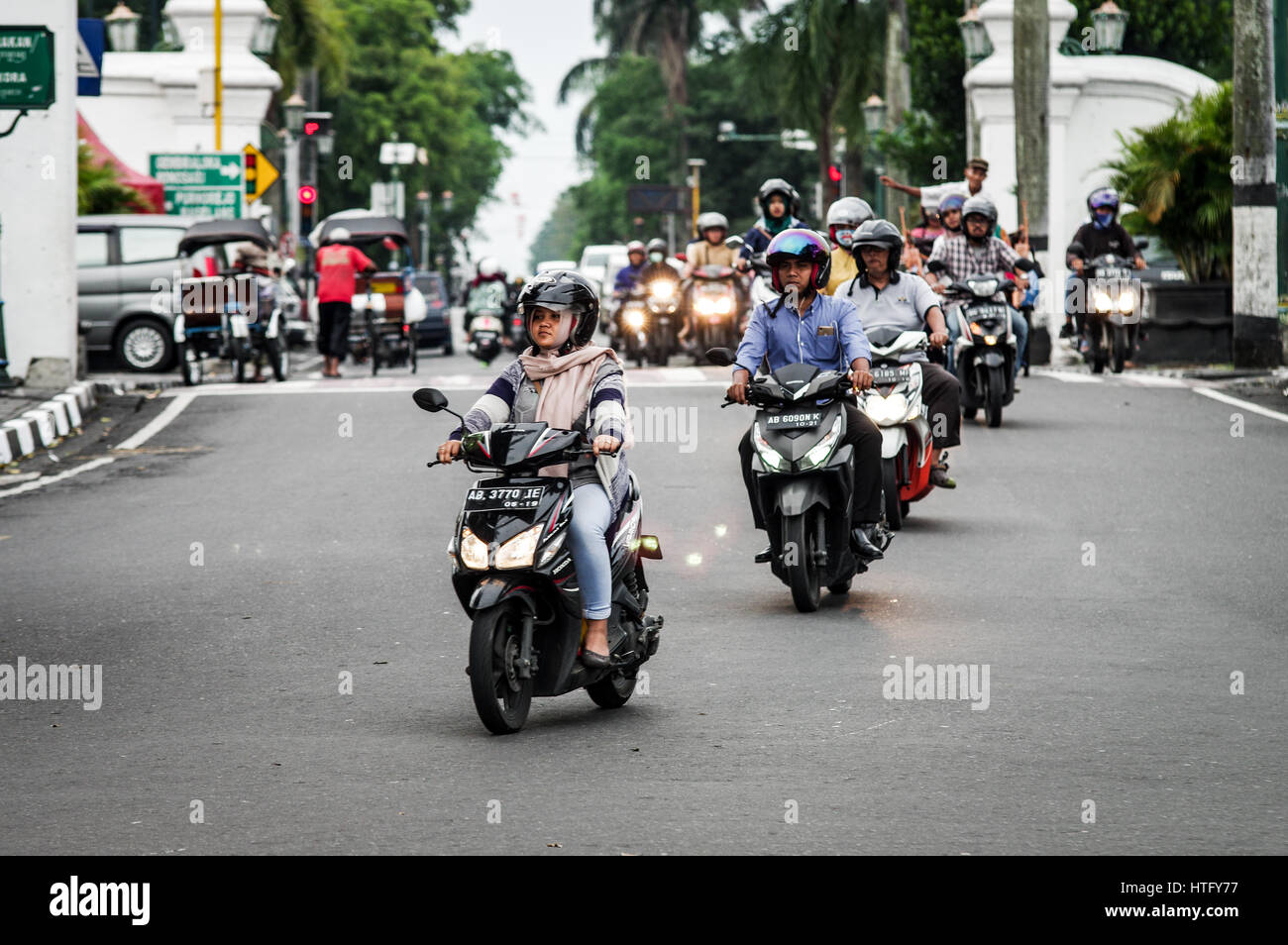 Mopeds crossing a busy junction in central Yogyakarta - Java, Indonesia - Stock Image