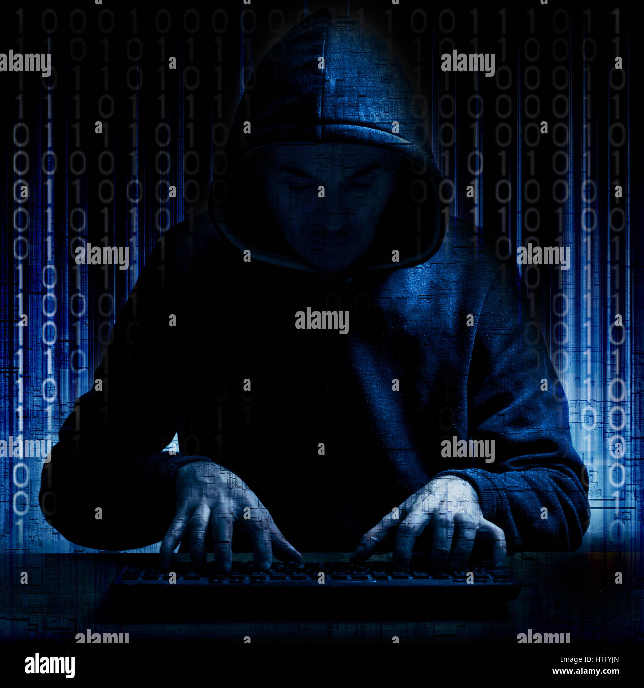 hacker in action - Stock Image