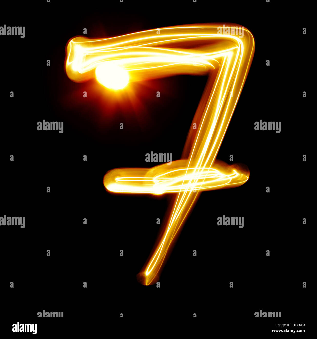 Seven - Created by light numerals over black background - Stock Image