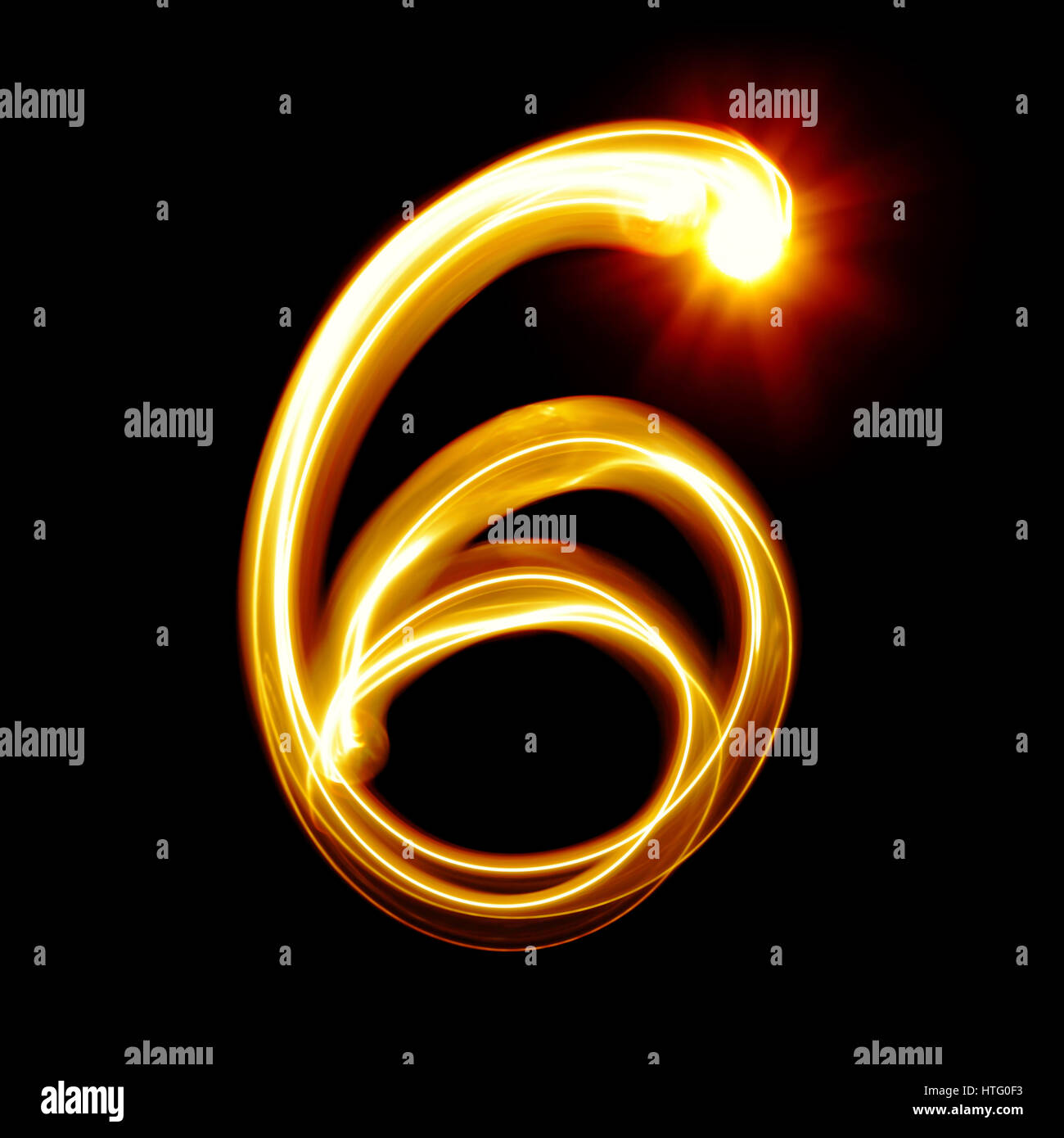 Six - Created by light numerals over black background - Stock Image
