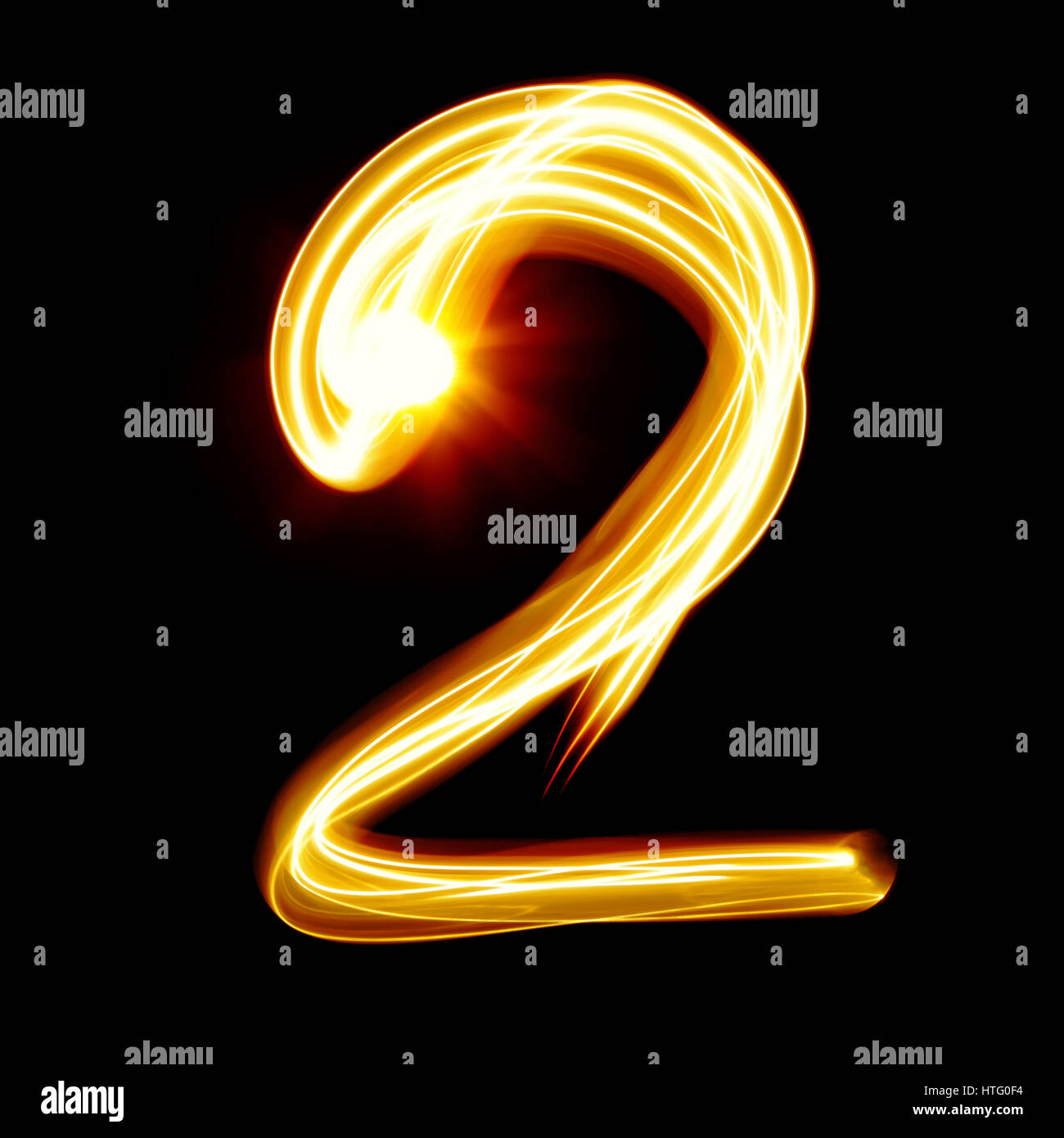 Two - Created by light numerals over black background - Stock Image