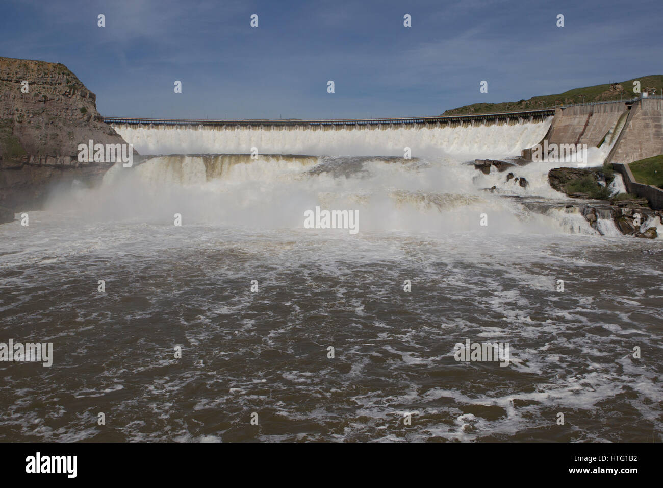 Late spring runoff storms over Ryan Dam and the Great Falls of the Missouri River. - Stock Image