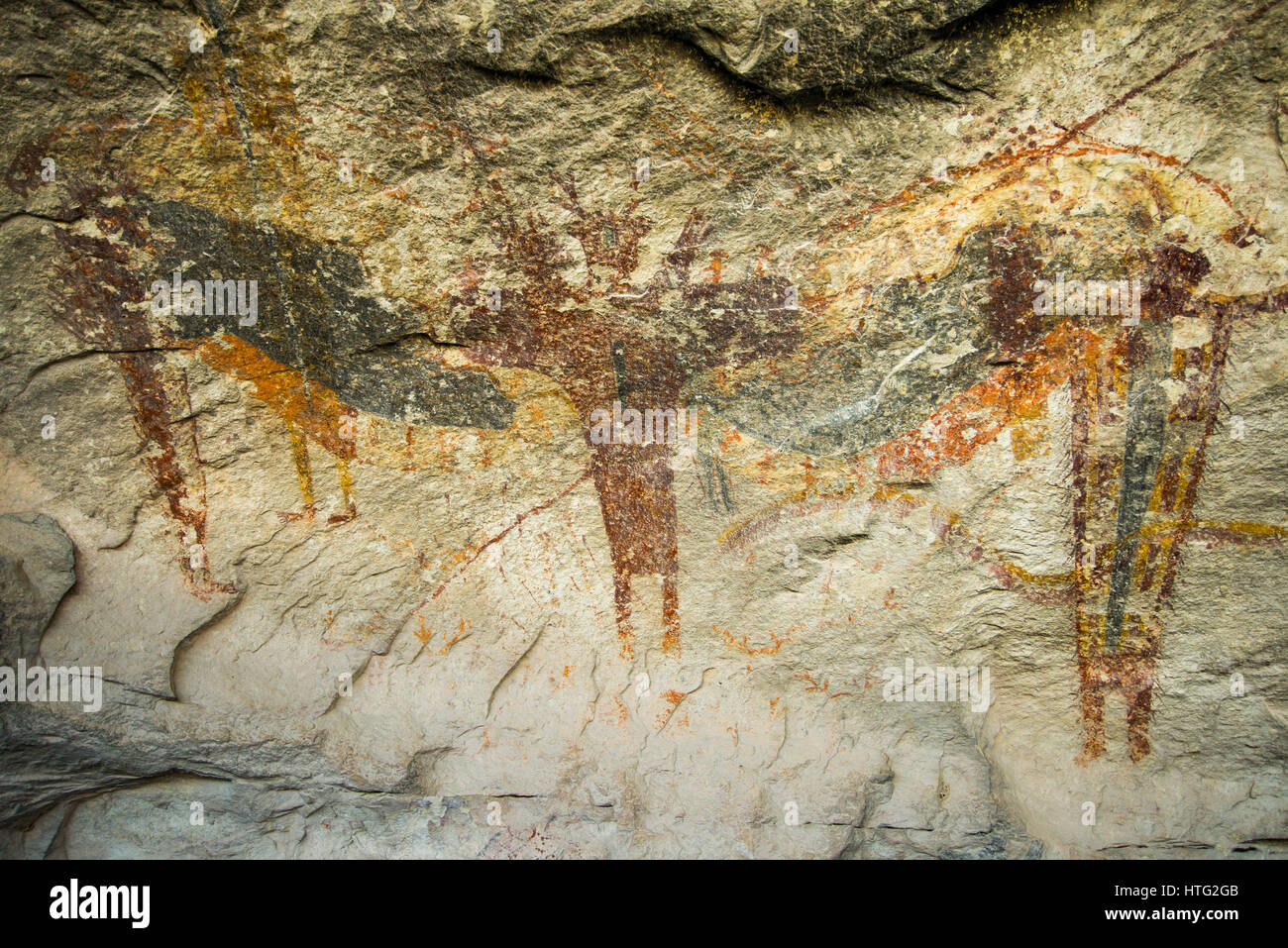 An historic Navajo pictograph drawn on a cave wall depicting people standing, Seminole Canyon, Texas - Stock Image