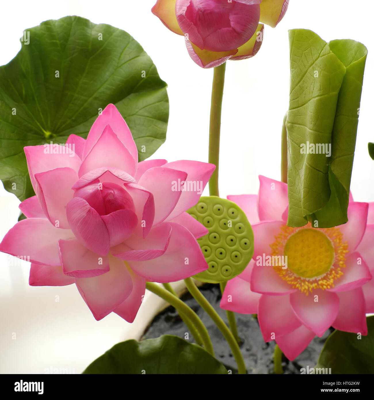 Artificial flower handmade clay lotus flower with green leaf pink artificial flower handmade clay lotus flower with green leaf pink petal diy art product for home decoration close up artwork on white background izmirmasajfo