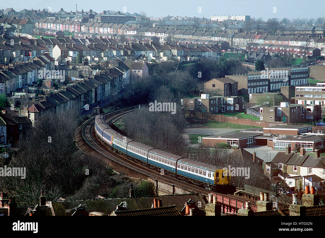 A pair of class 415 4EPBs heads west with a NSE North Kent service at Chatham. 15th March 1993. - Stock Image