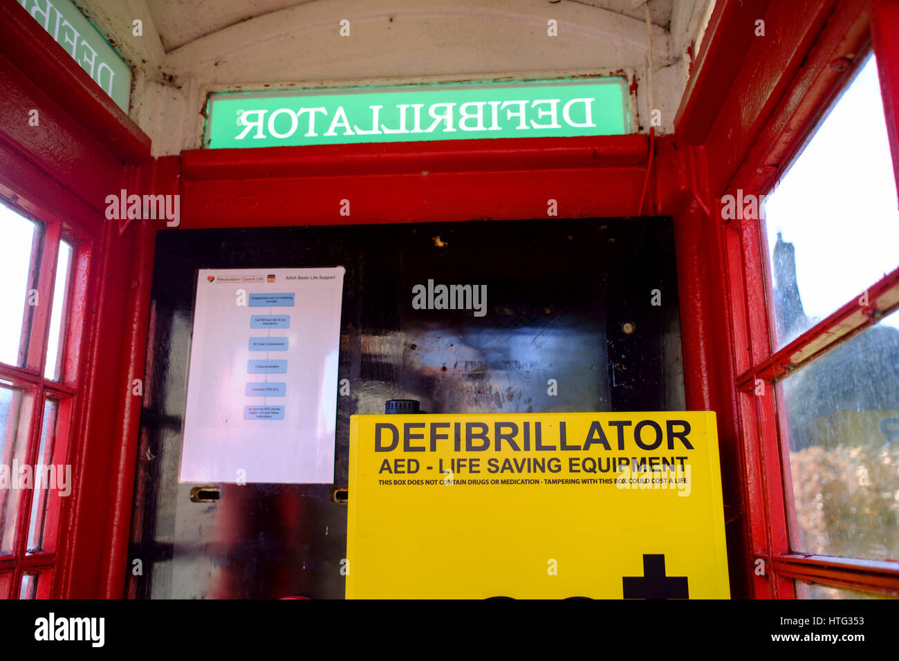 Wellow a somerset village Near Bath England UK Defibrillator in old K6 telephone kiosk - Stock Image