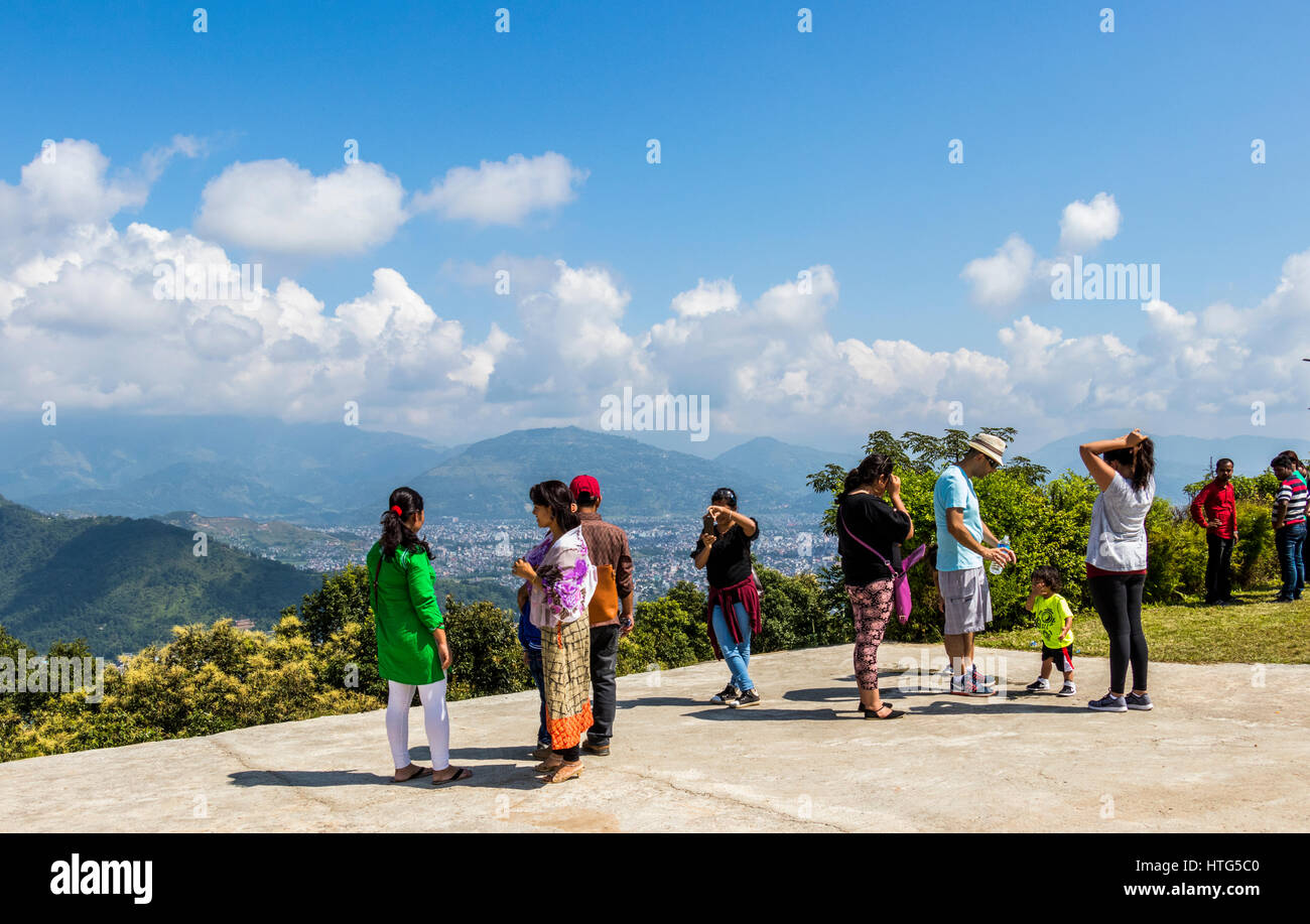 People enjoying view on hillside overlooking city of Pokhara Nepal - Stock Image