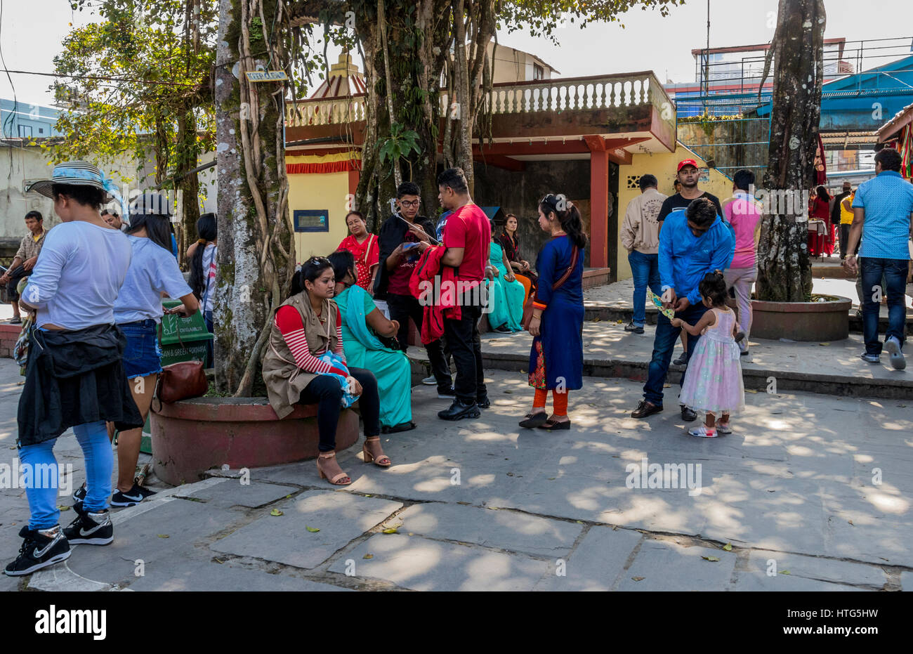 Locals and tourist in town of Pokhara in Nepal - Stock Image