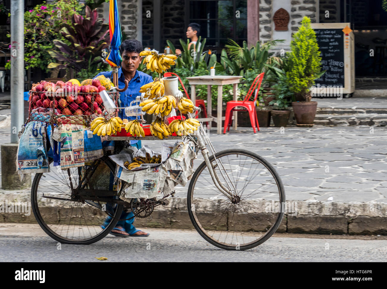 mobile vendor on cycle selling fruit in Pokhara Nepal - Stock Image