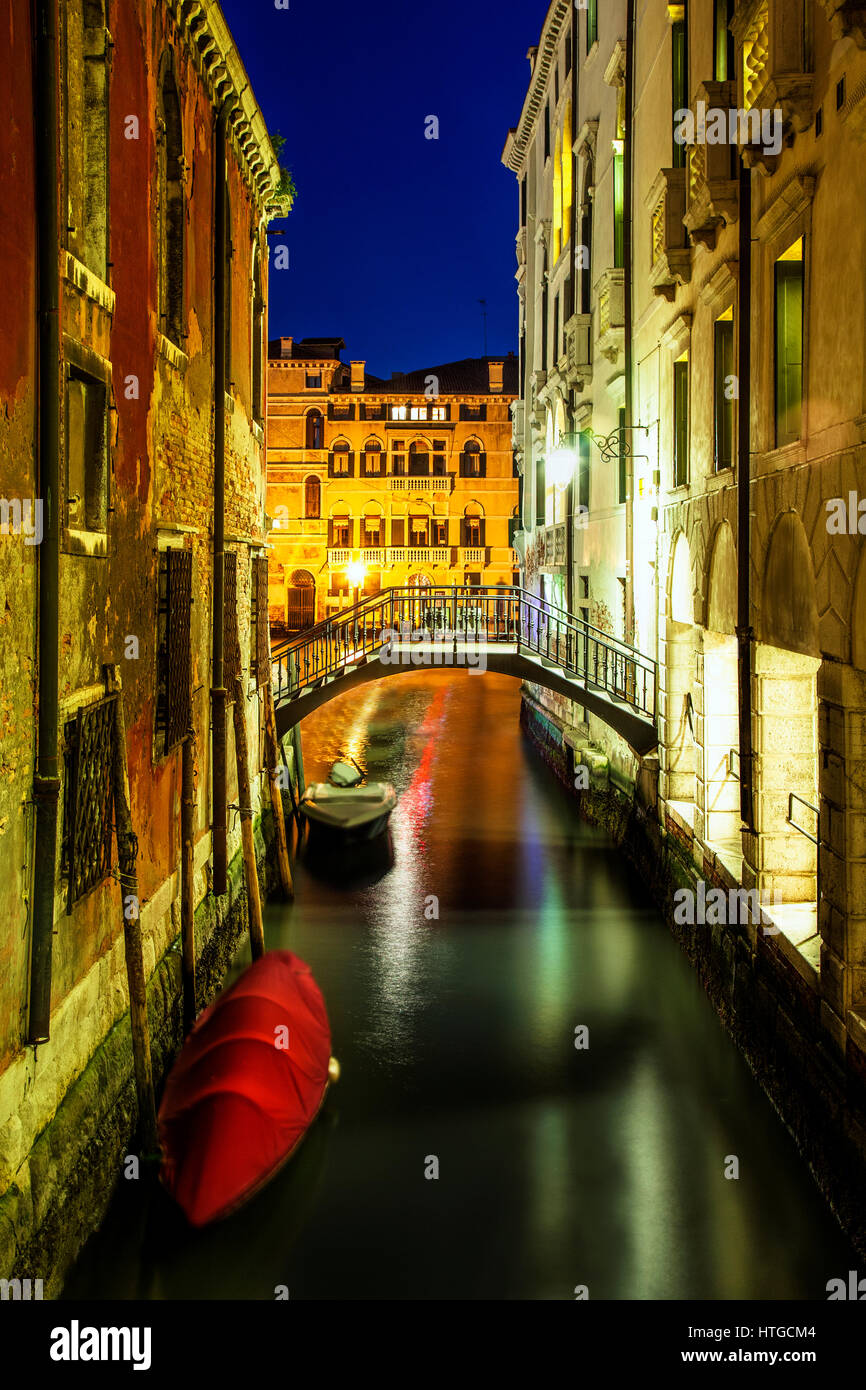 Quiet canal in Venice at twilight.  In the background is the Grand Canal. - Stock Image