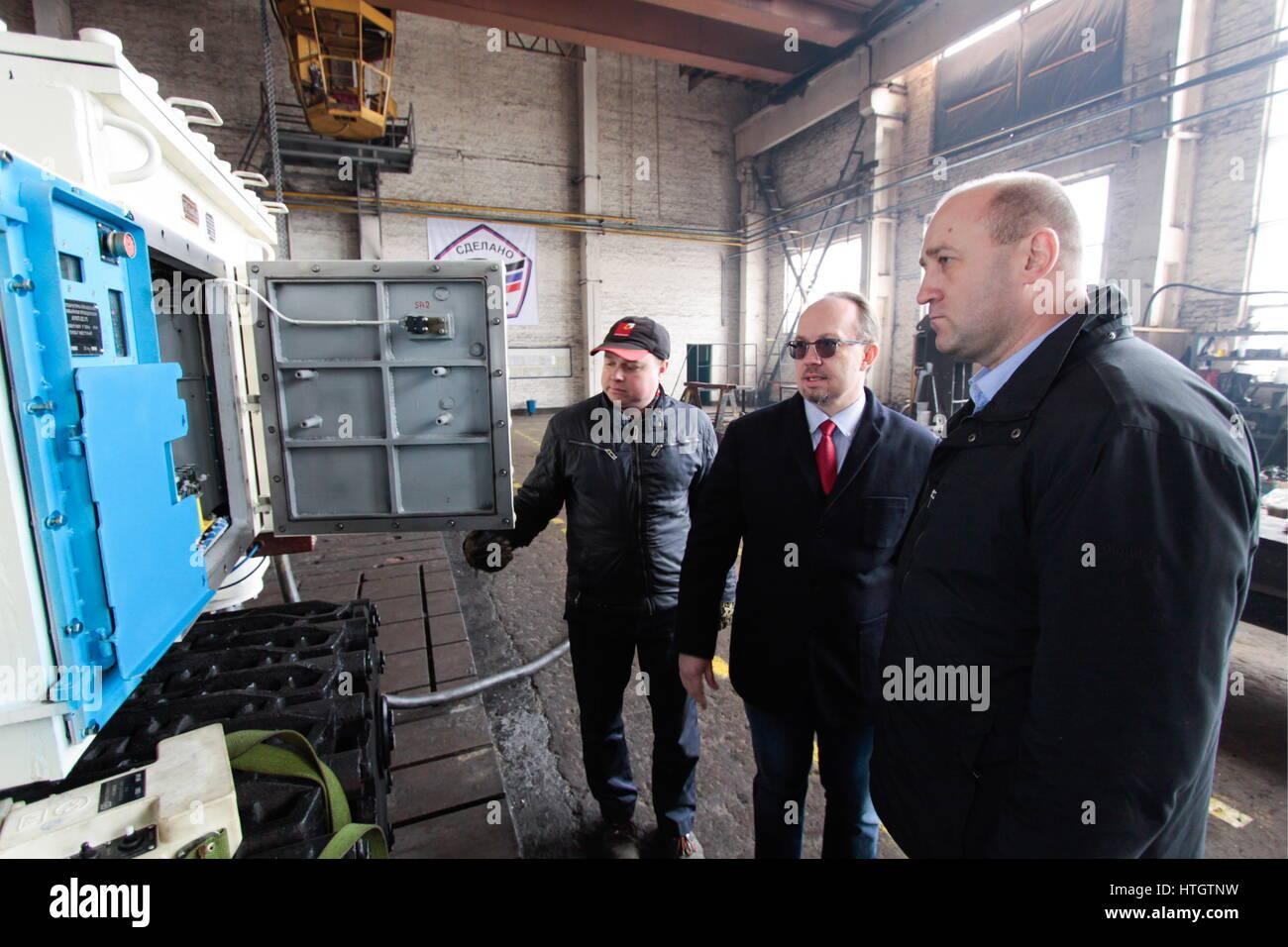 Donetsk, Ukraine. 14th Mar, 2017. Yasinovatsky Machine Building Plant chief designer Konstantin Lomakovsky (C) and - Stock Image