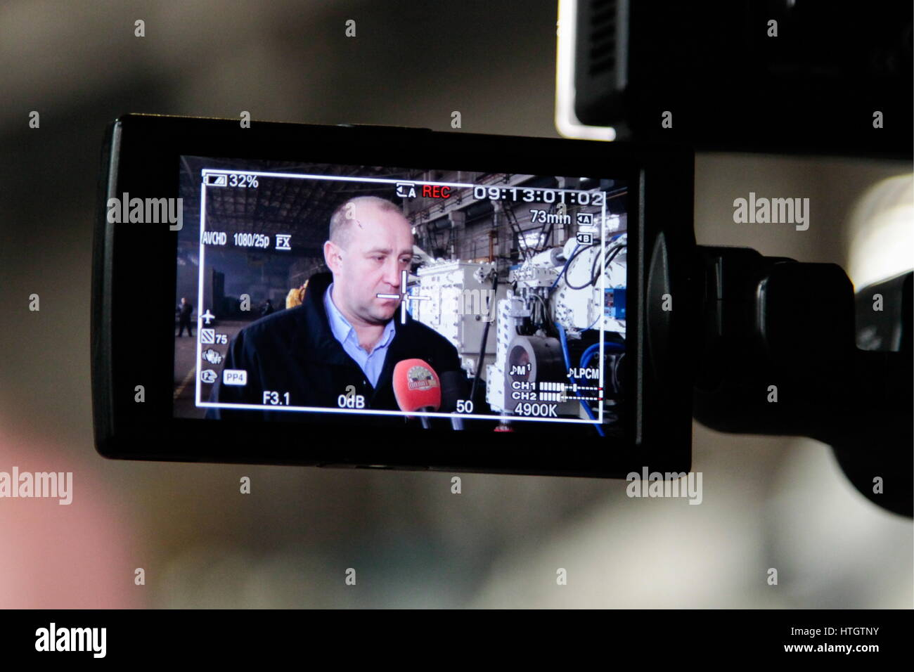Donetsk, Ukraine. 14th Mar, 2017. Alexei Granovsky (on the screen), acting industry and trade minister of the Donetsk - Stock Image