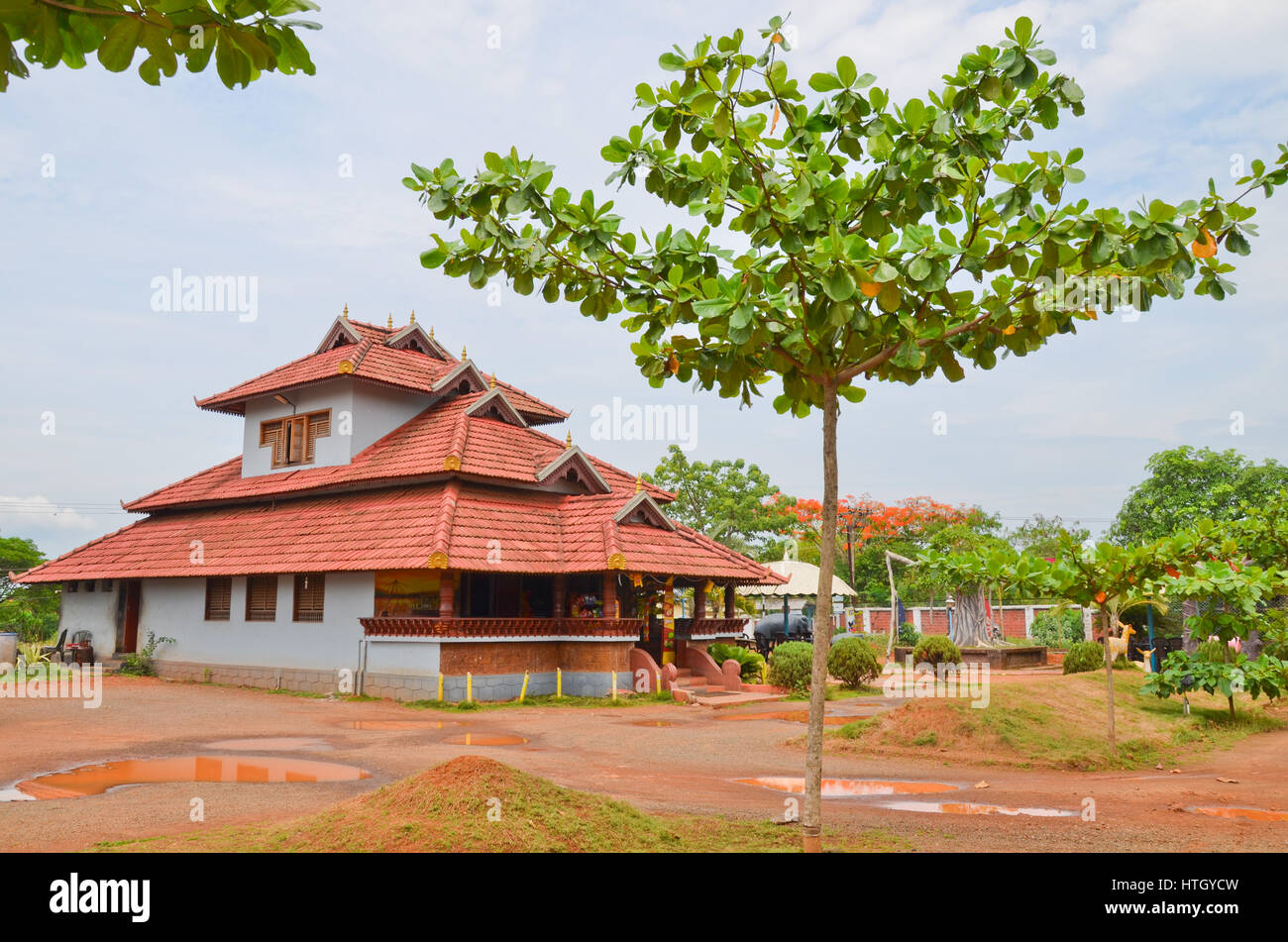 Traditional Architecture Of A Tiled Roof House In Kerala Using