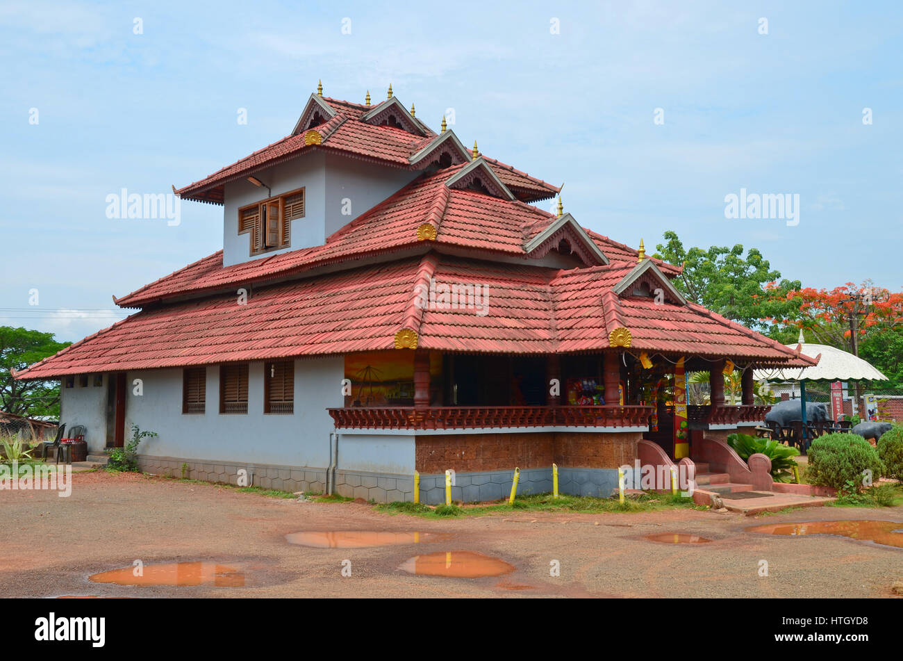 Traditional Architecture Of A Tiled Roof House In Kerala, Using Mainly Wood  Mangalore Tiles