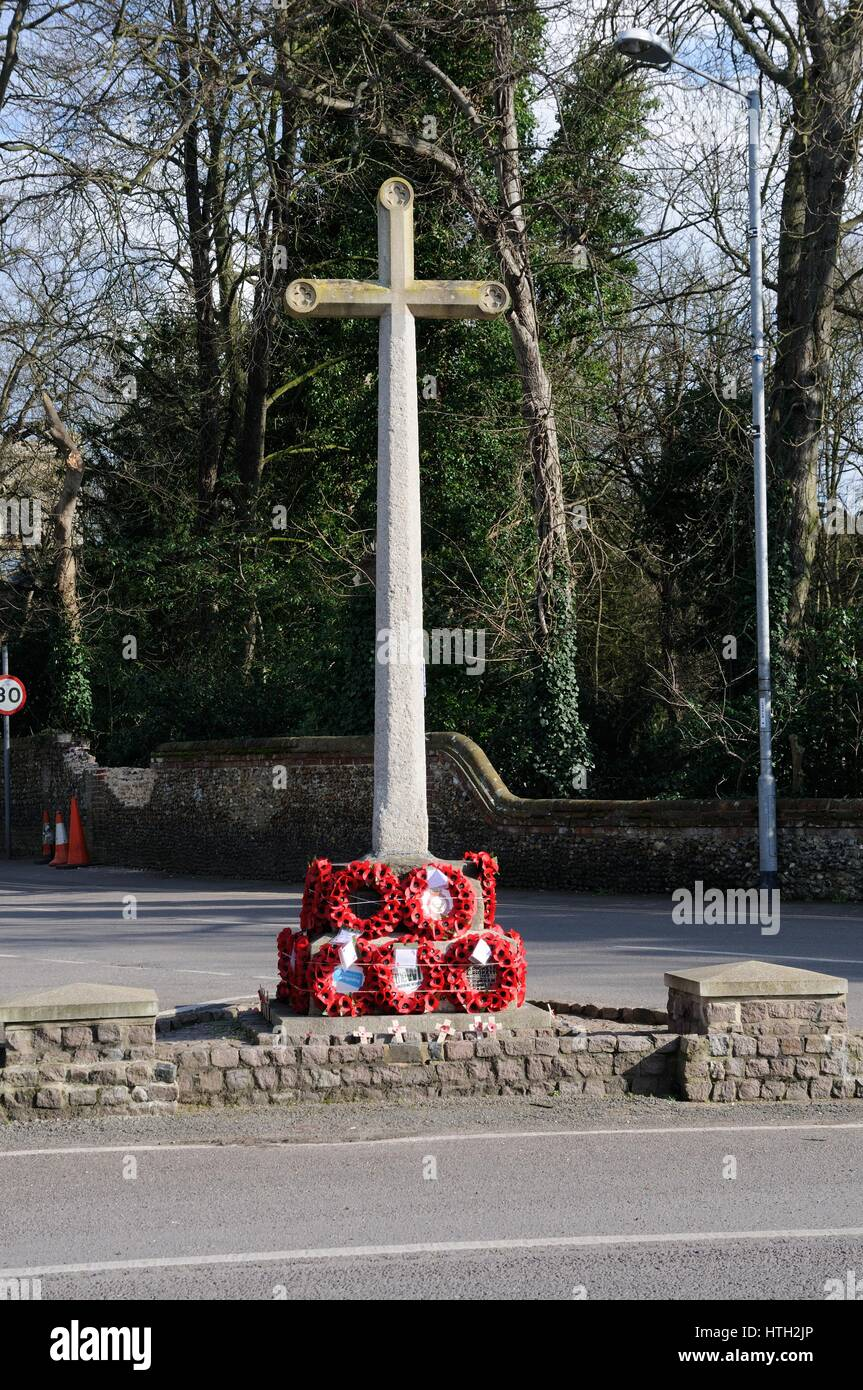 War Memorial, Sawston, Cambridgeshire, remembers those who died in two world wars and the Korean War. Stock Photo