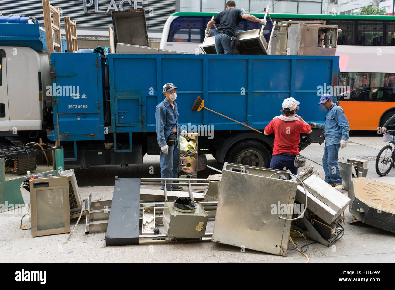 Metal appliances hardware and metal scraps removal by workers in Hong Kong - Stock Image