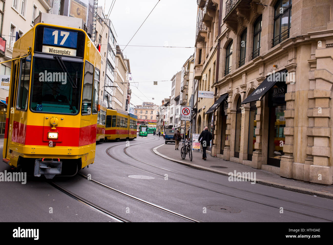 Basel, Switzerland - March 2017: Yellow tram in street of Basel city center. Basel's green and yellow trams - Stock Image