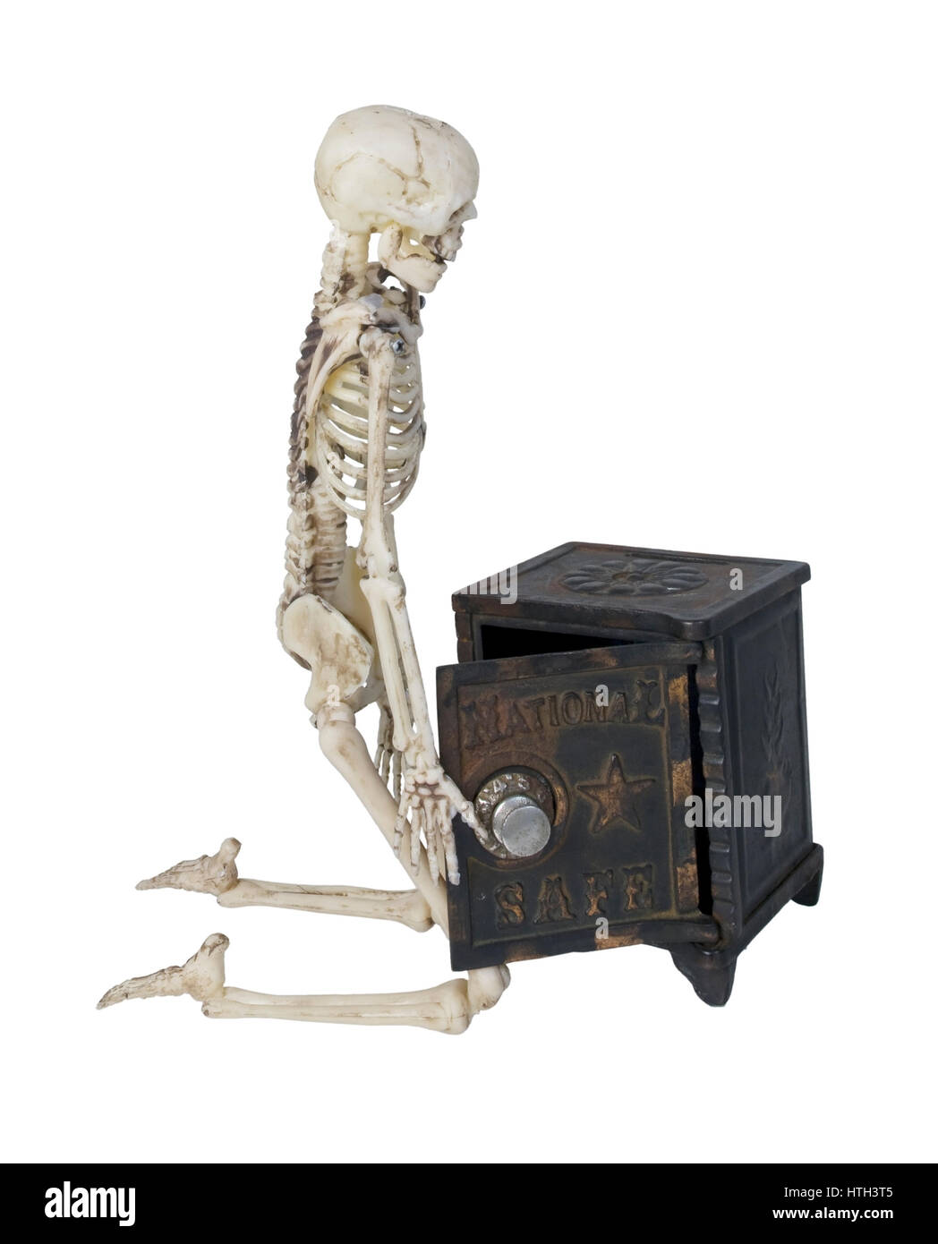 Skeleton with a safe used to store securities and money - path included - Stock Image