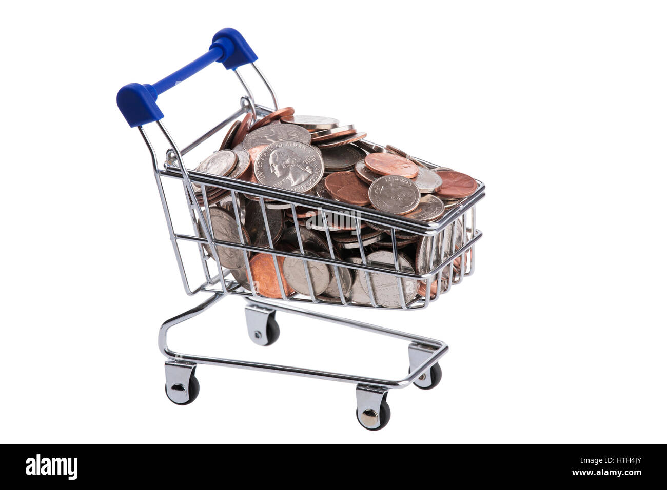 A miniature shopping cart filled with US coins isolated on a white background - Stock Image