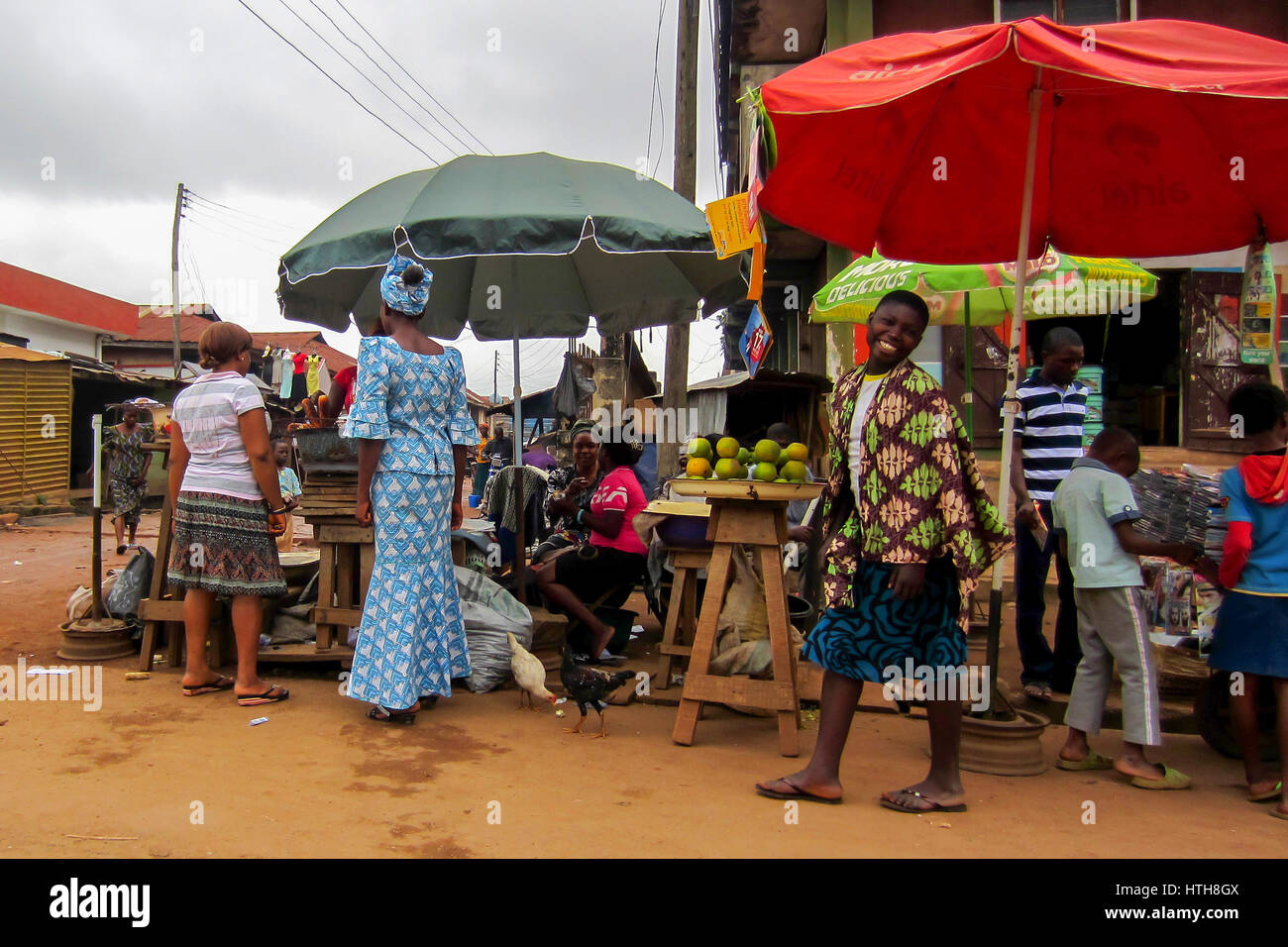 People selling different goods in the street in the city of Lagos, the largest city in Nigeria and the African continent - Stock Image
