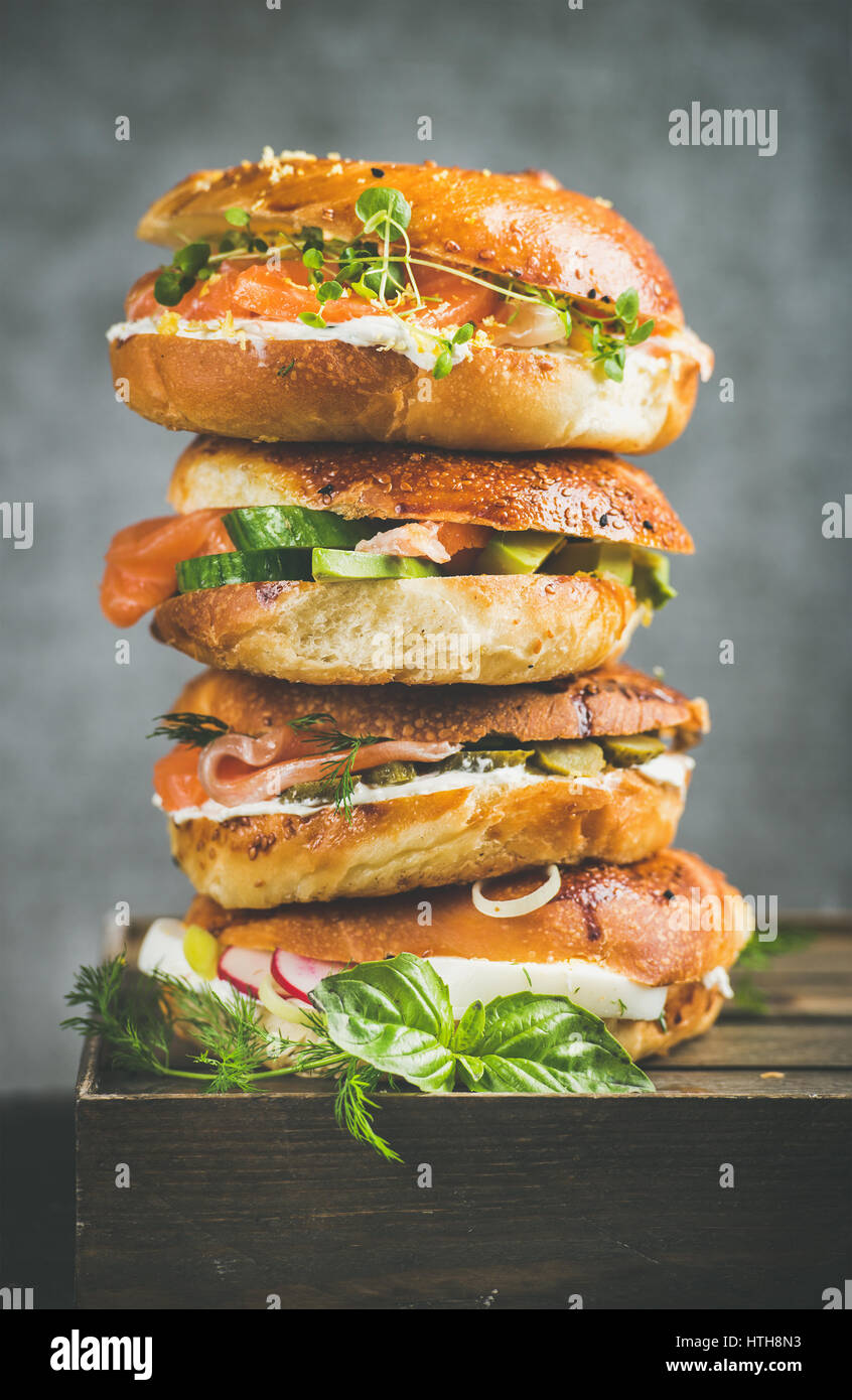 Heap of Bagels with salmon, eggs, vegetables, capers and cream-cheese - Stock Image