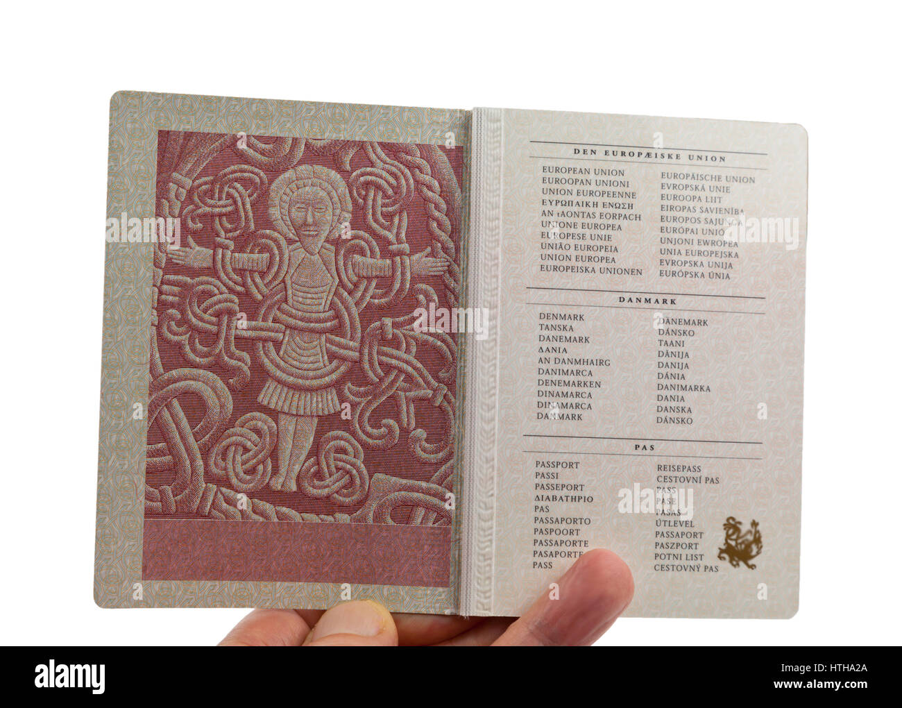 Page 2 in the Danish passport displays the figure of Christ from the Jelling rune stone raised by Viking king Harald Stock Photo