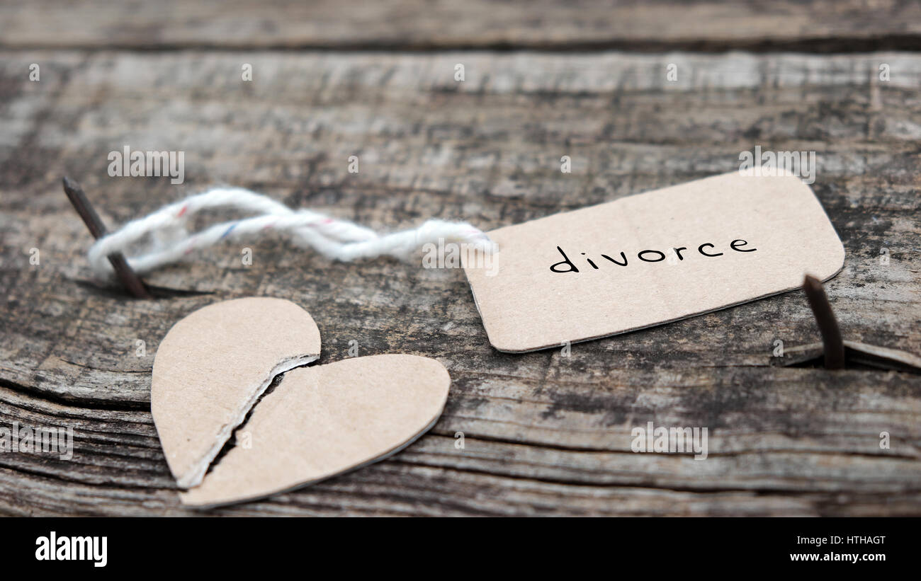 Divorce background with broken heart and message on wooden, unhappy marriage and adultery problem make stress life, - Stock Image