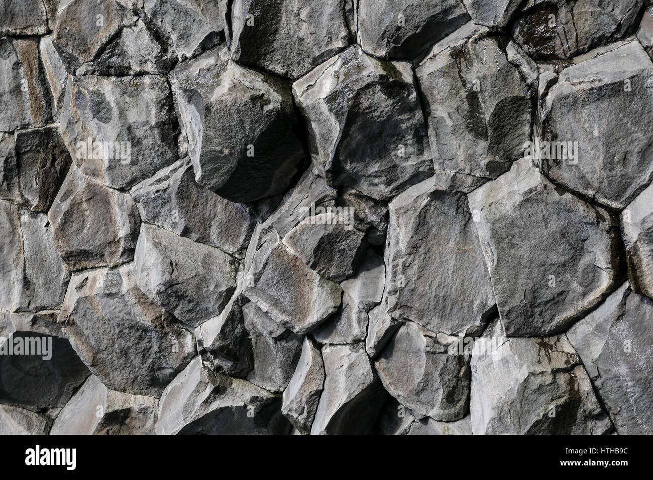 Volcanic hexagonal basalt rock formation for natural abstract background pattern, Reynisfjara, Iceland - Stock Image